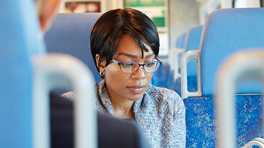 Photo of a woman sitting on a GO Train.