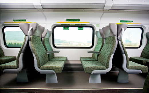 Photo of a new GO Train cab car interior, with brand new seats.