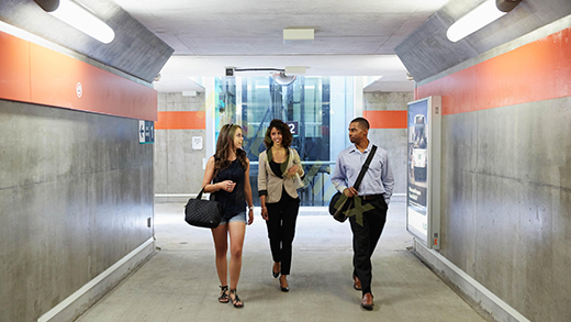 Passengers using a tunnel at a GO Train Station.