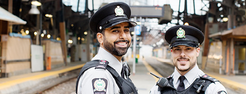 Photo of two Transit Safety Officers smiling on the platform at Union Station.