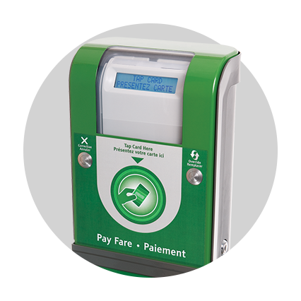 A short green machine that has both a screen for messages and a circle for tapping your PRESTO card.