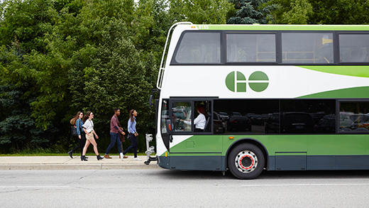 Photo of a GO Bus and driver waiting as students board.