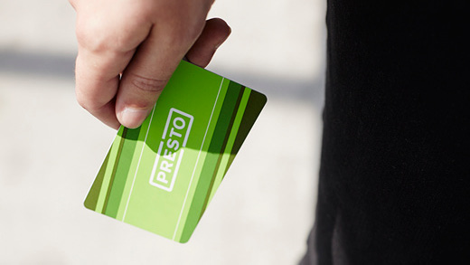Customer holding a PRESTO card in their hand.
