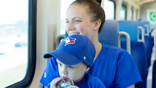 Mother and son going to blue jays game