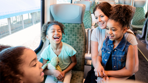 Happy family on GO train