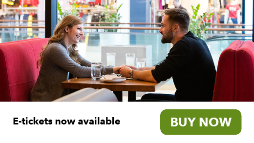 Couple dining at a restaurant GO e-tickets available buy now button