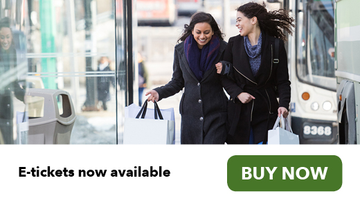 Two women shopping with bags next to GO bus e-tickets online buy now button