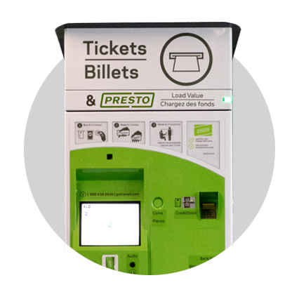 A ticket vending machine that has a screen, a keypad, and slots for inserting your credit or debit card, as well as your PRESTO fare card.